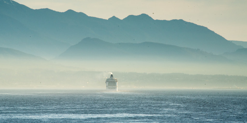 Ship emerges from fog