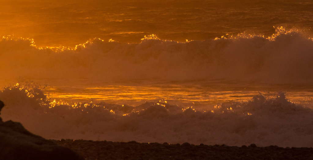 Backlit surf at sunset