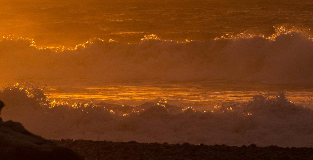 Backlit surf at sunset