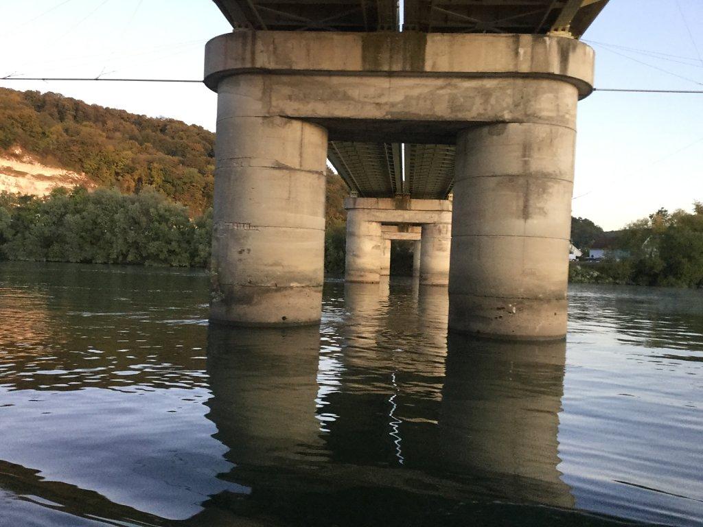 under a (symmetrical) bridge